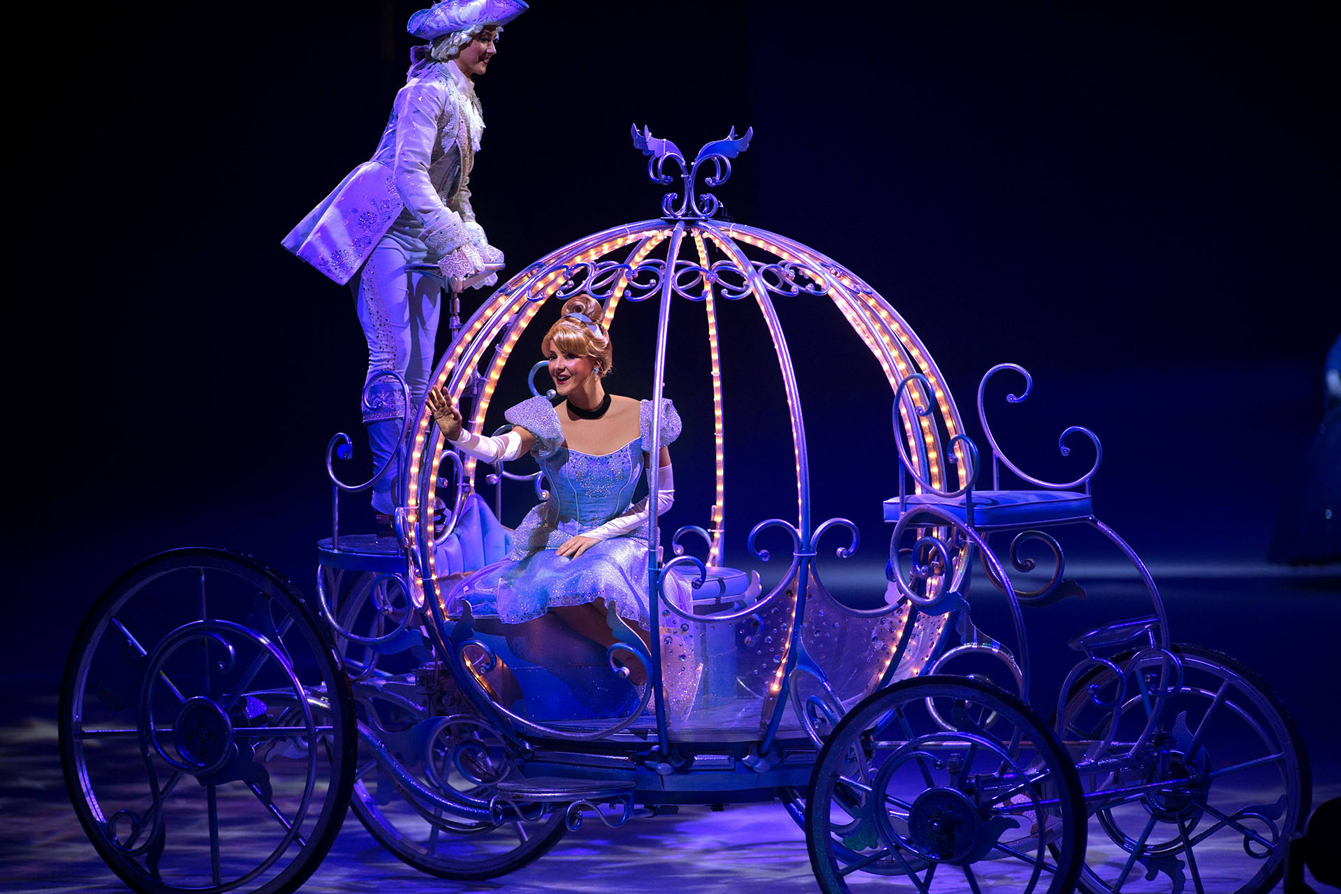 Cinderella rides in her magical pumpkin carriage