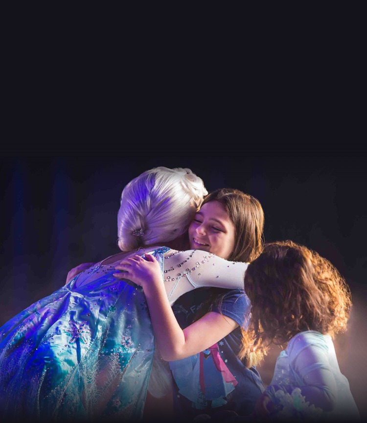 Elsa hugs little girl from the audience