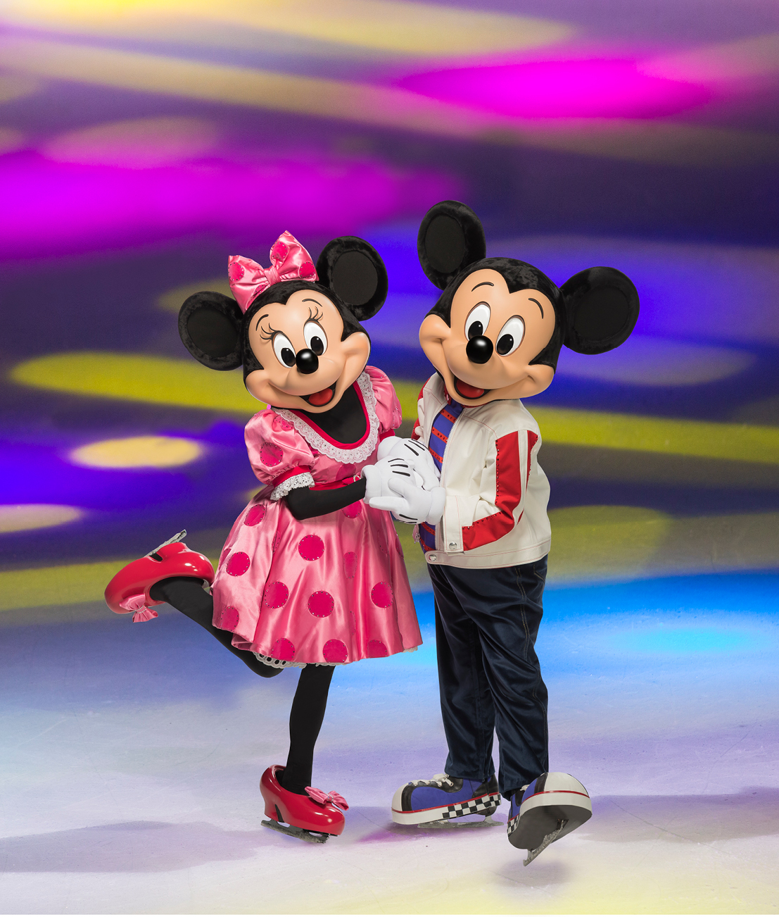 Mickey and Minnie holding hands and skating on ice