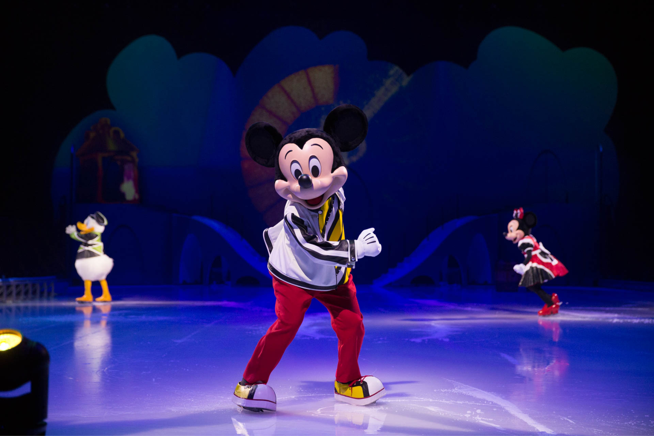 Mickey Mouse, Minnie Mouse and Donald Duck skating on ice
