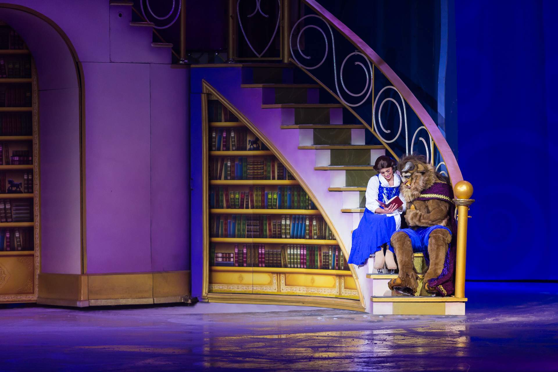 Beauty and Beast sitting on a spiral staircase