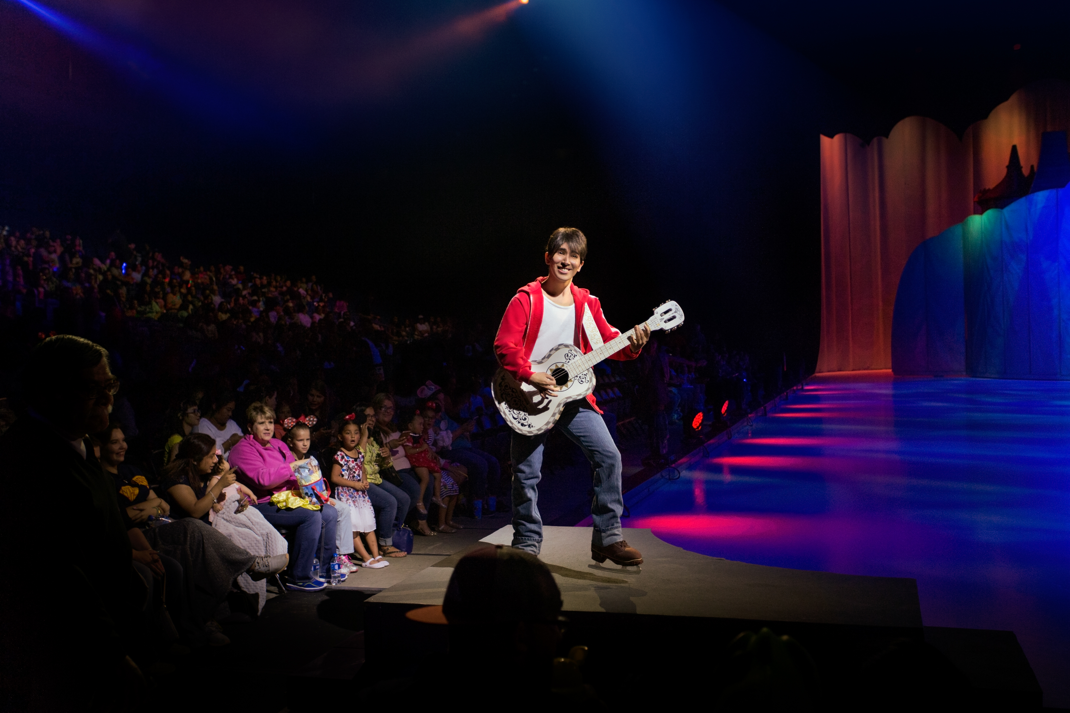 Disney's Miguel playing guitar on ice